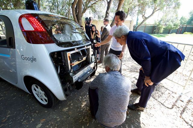 secretary_kerry_views_the_computers_inside_one_of_googles_self-driving_cars_at_the_2016_global_entrepreneurship_summits_innovation_marketplace_at_stanford_university_27786624121